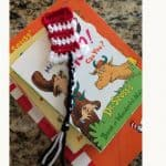 Red white striped hat bookmark on Dr. Seuss books.