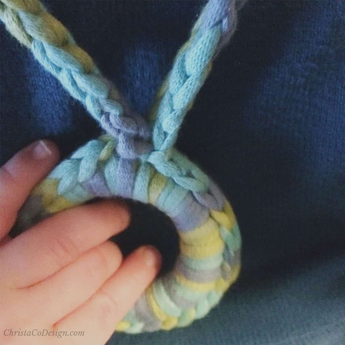 picture of baby hand on nursing necklace