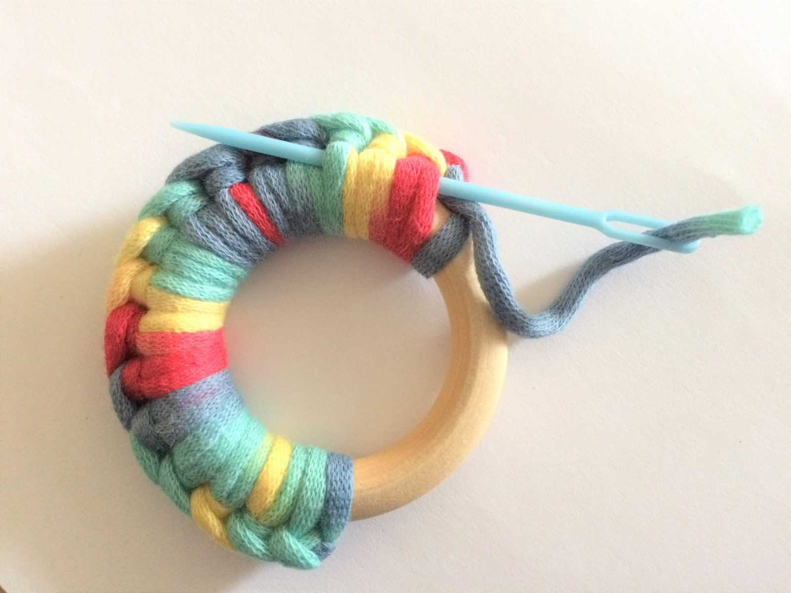 Sewing tail into crochet teether.