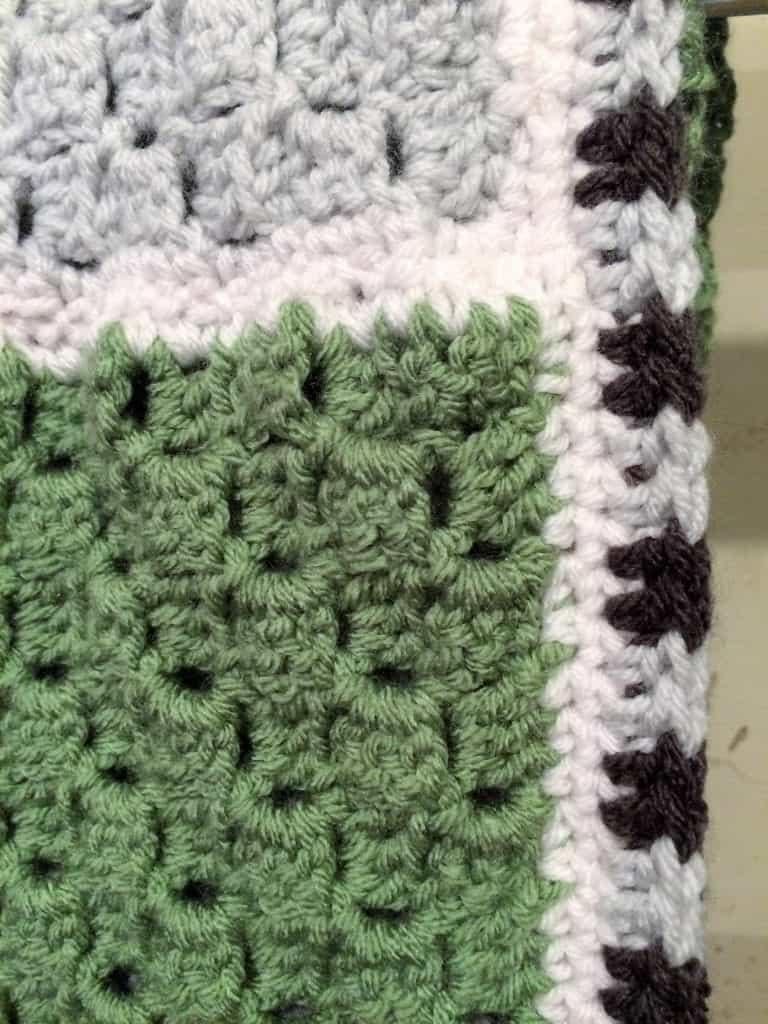 picture of striped border on corner to corner crochet blanket