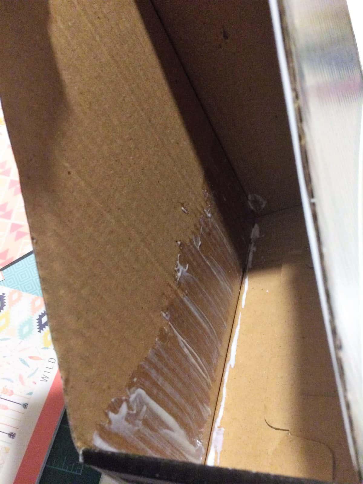 Glue on inside of magazine holder box makeover.