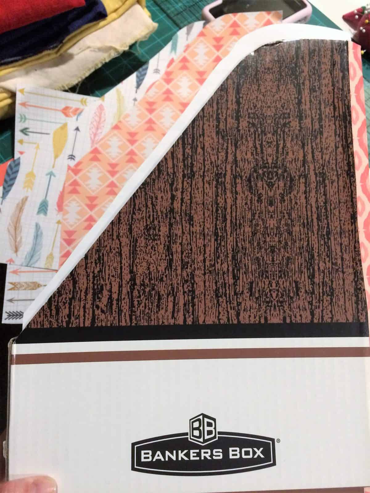 Use the cardboard magazine holder as a template to cut the paper.