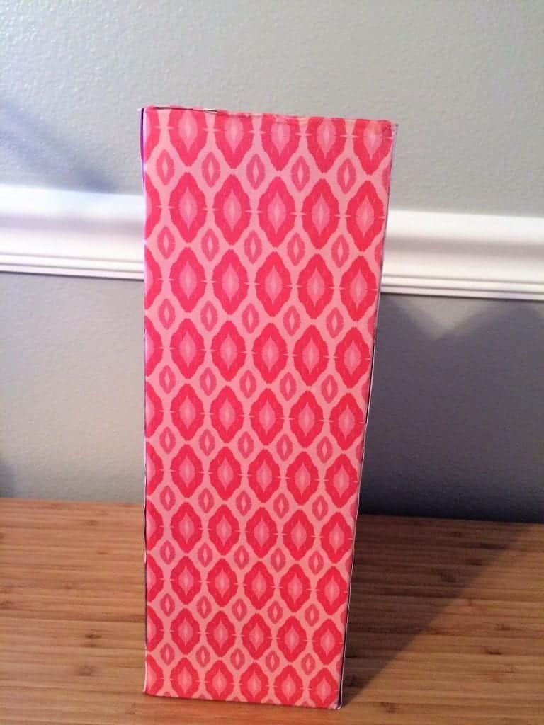 Back of magazine holder covered in pink oval paper.