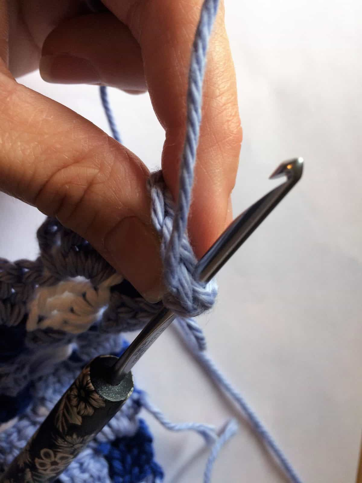 Insert hook for slip stitch.