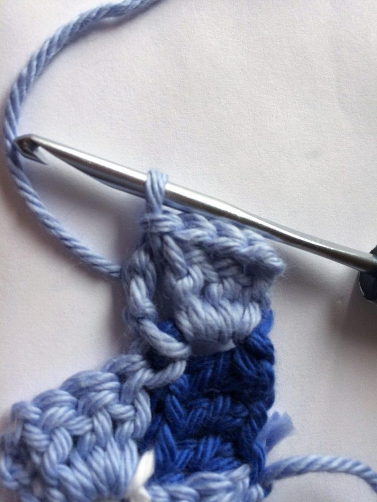Slip stitch across block for gingham crochet pillow.
