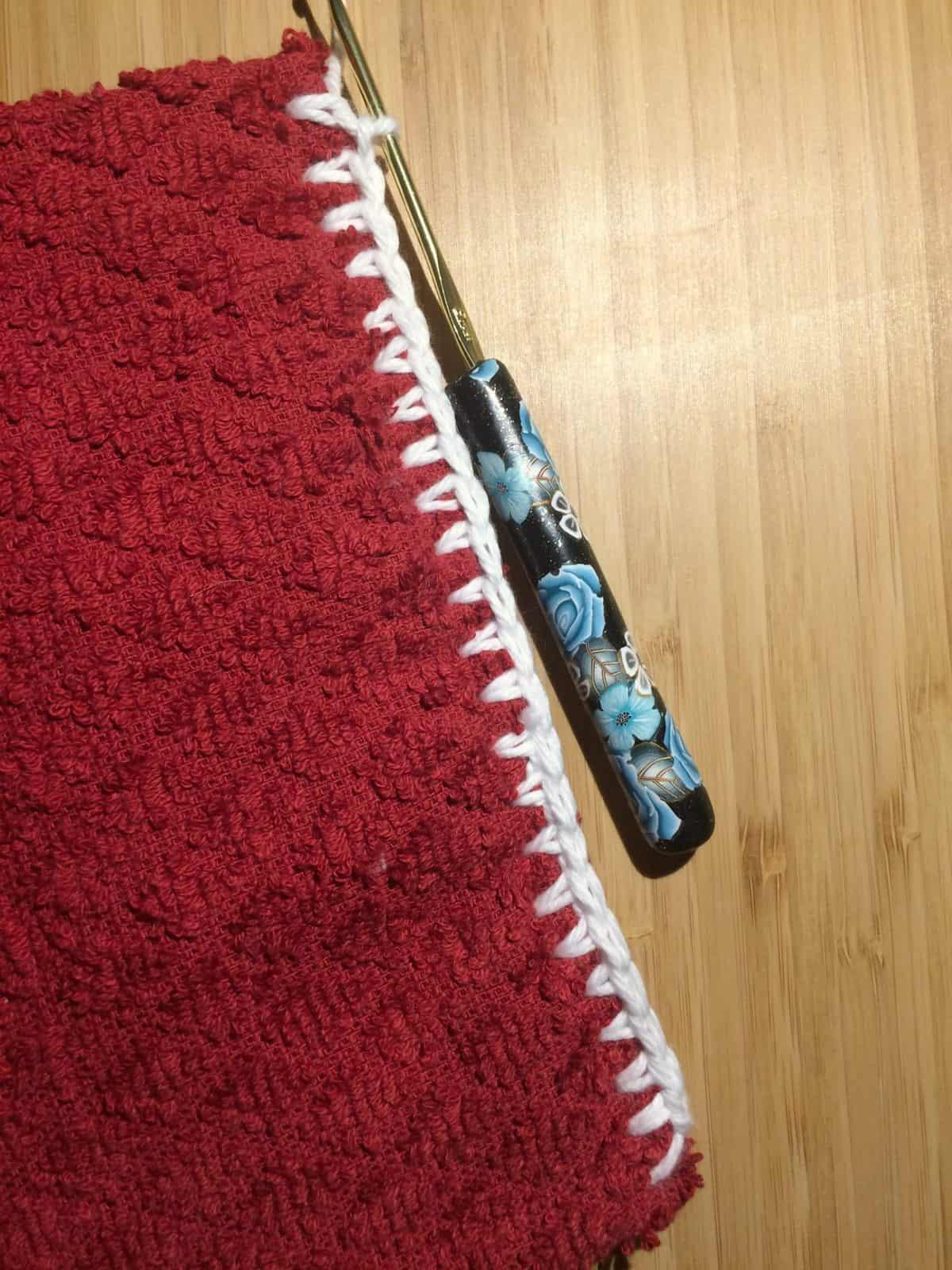 Single crochet along towel topper.