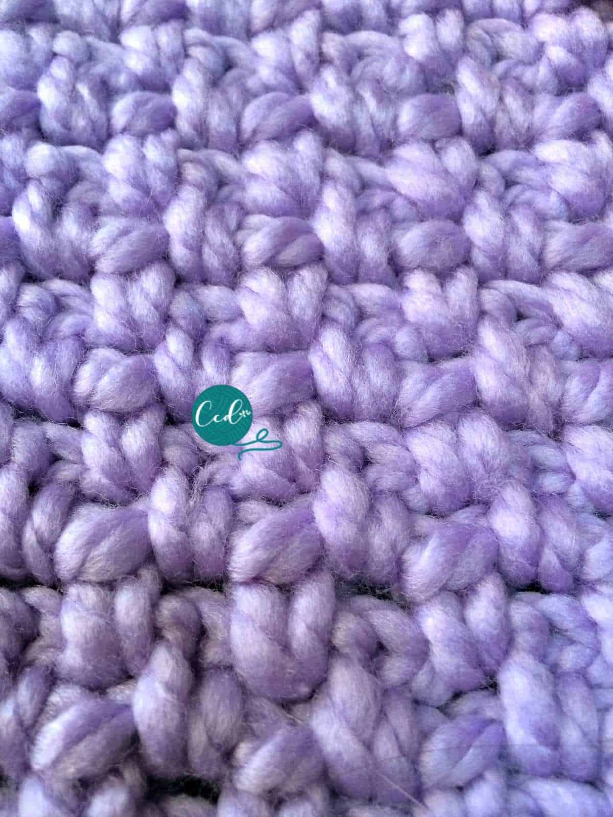 Close up of purple stitches for crochet tablet cover.