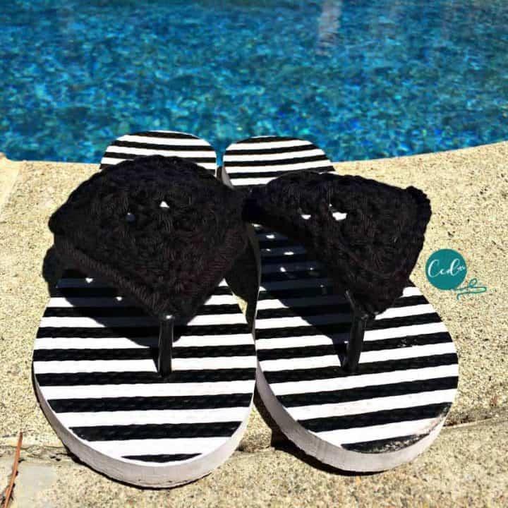 Black crochet sandals by pool.