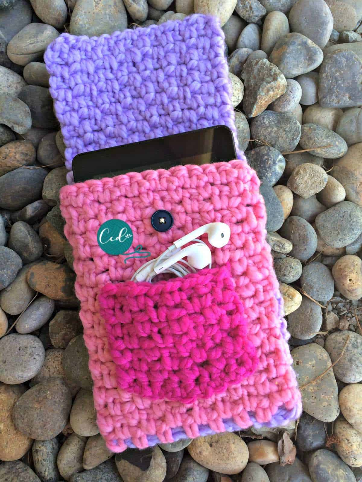 Pink crochet tablet cover with flap open.
