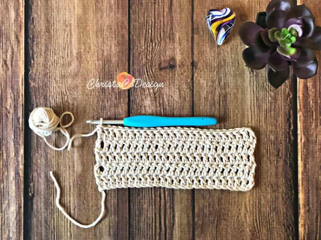 A crochet swatch started with standing stitches.
