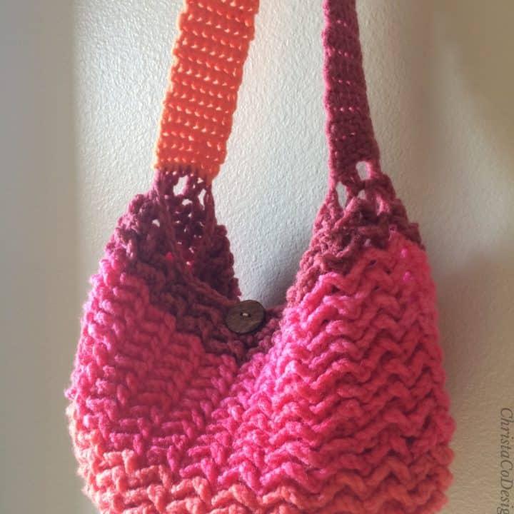 Pink and orange striped crochet bag hanging.