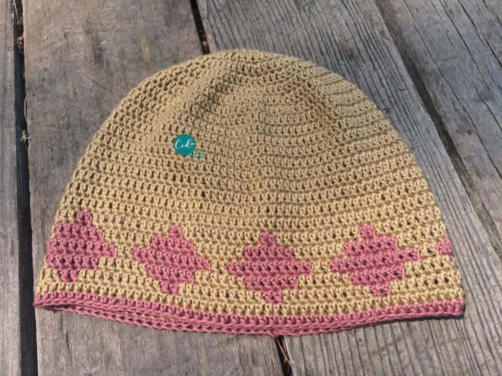 Beige with pink diamond chemo cap.