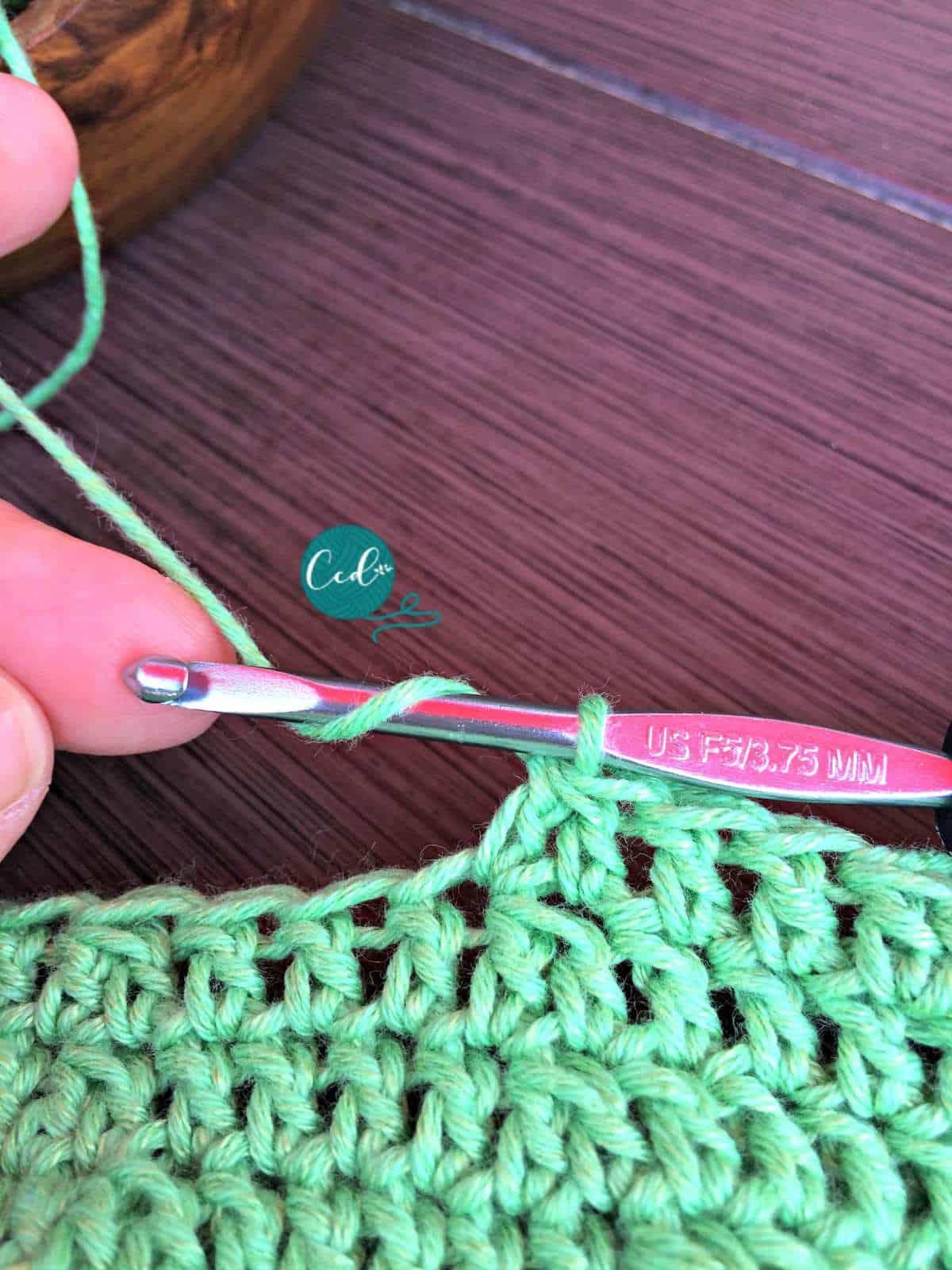Yarn over to decrease the double crochet.