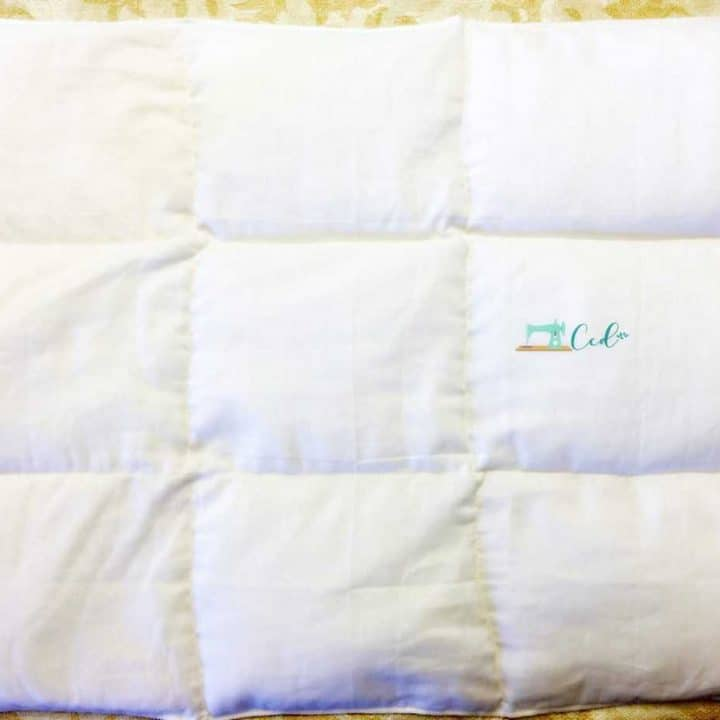 White segmented weighted lap pad.