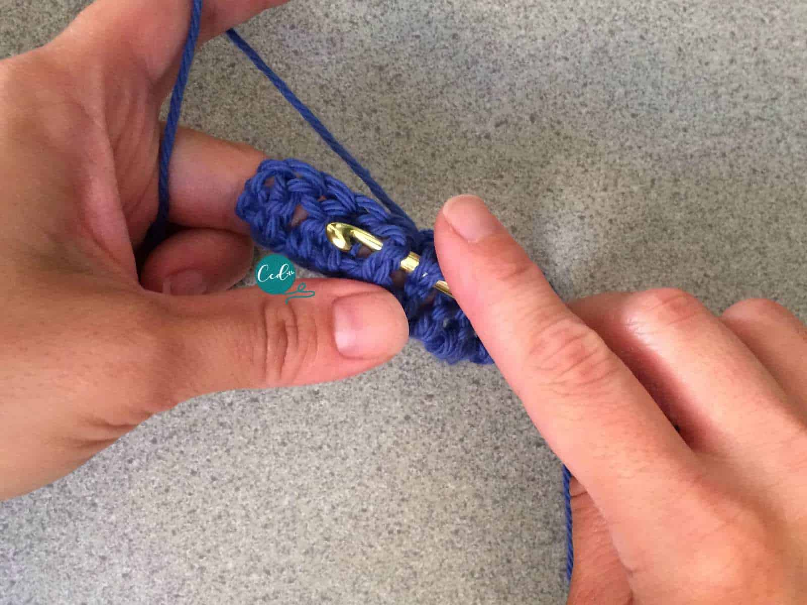 Hook behind the post of the double crochet.