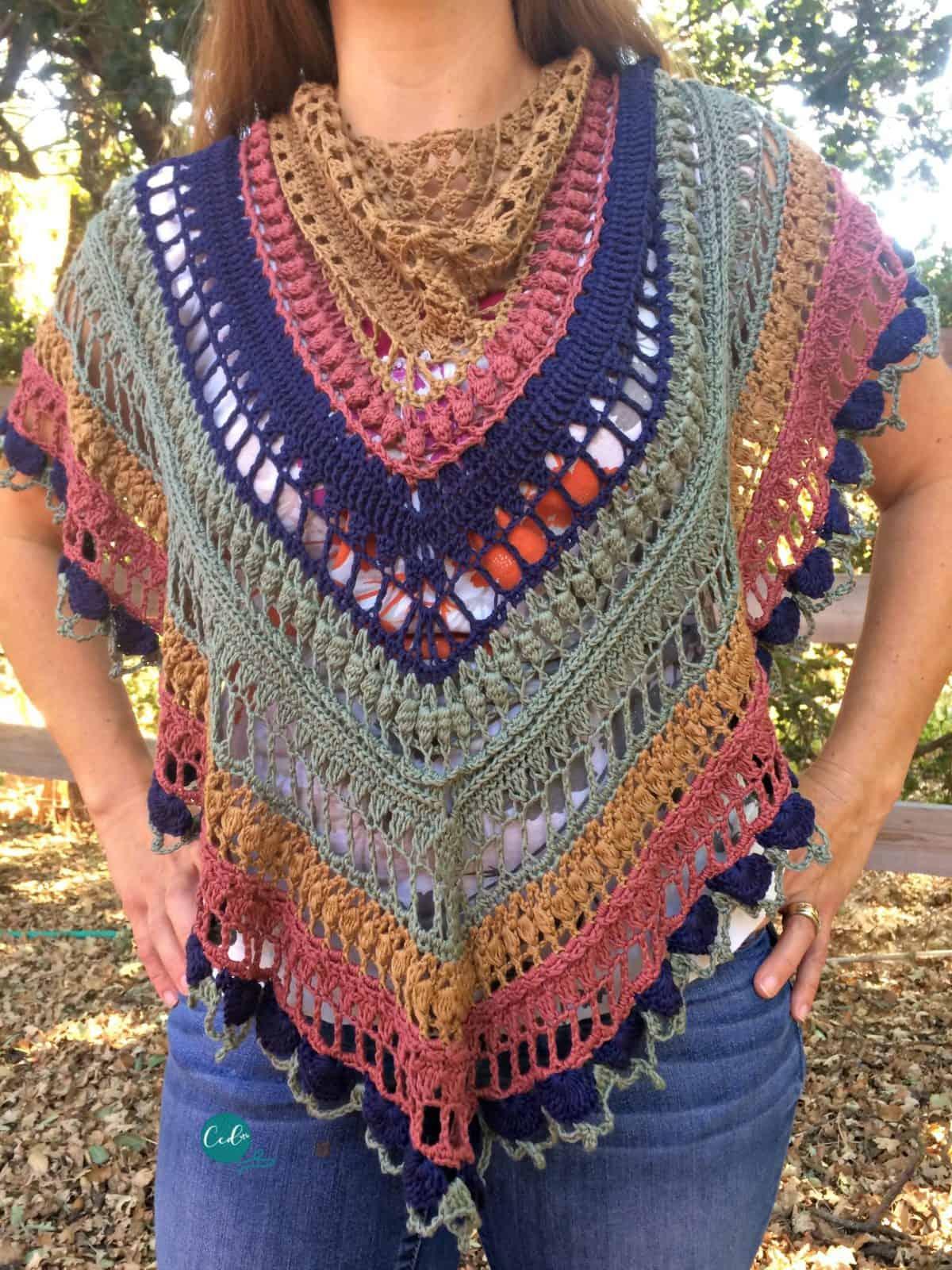 Woman in multicolored, lacy shawlette.