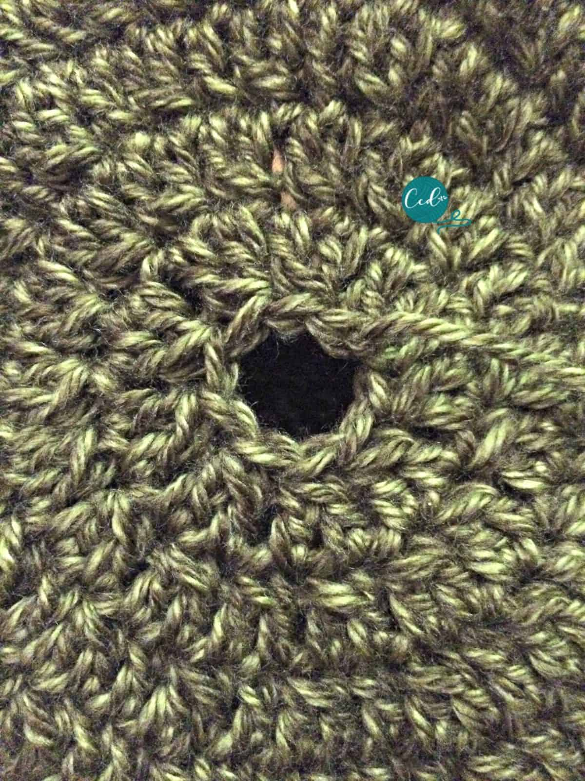 Hole in top of textured slouchy hat.