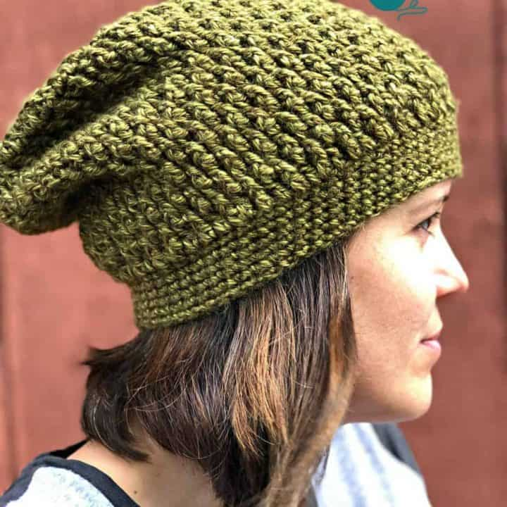 Woman in textured green slouchy hat.
