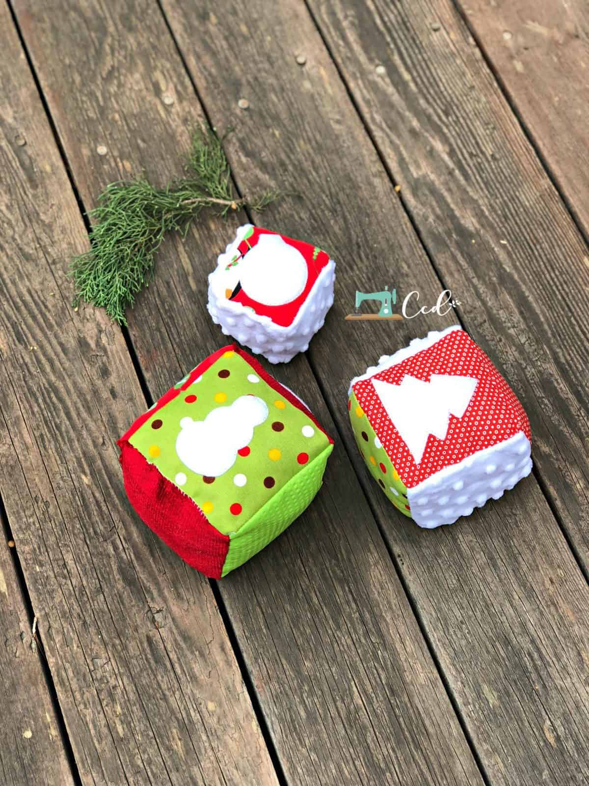 Christmas blocks with snowman and tree.