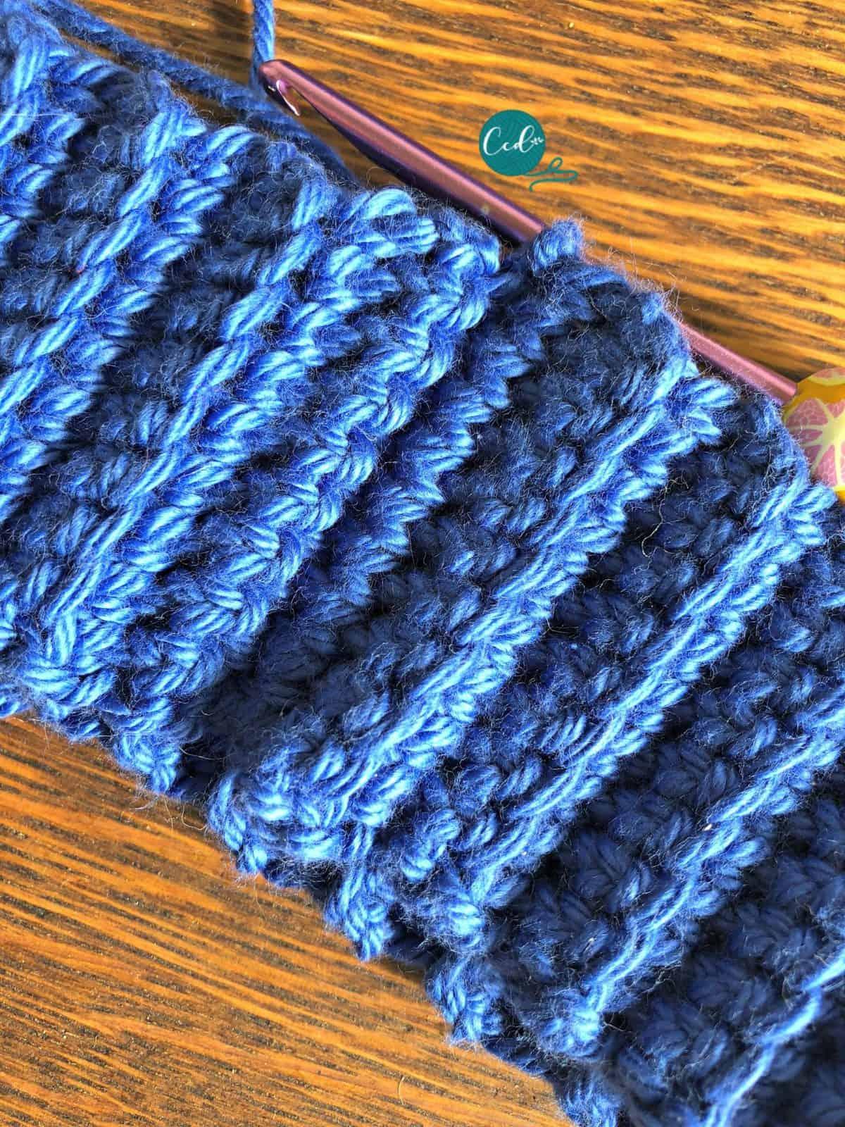 Ribbing in blue yarn.