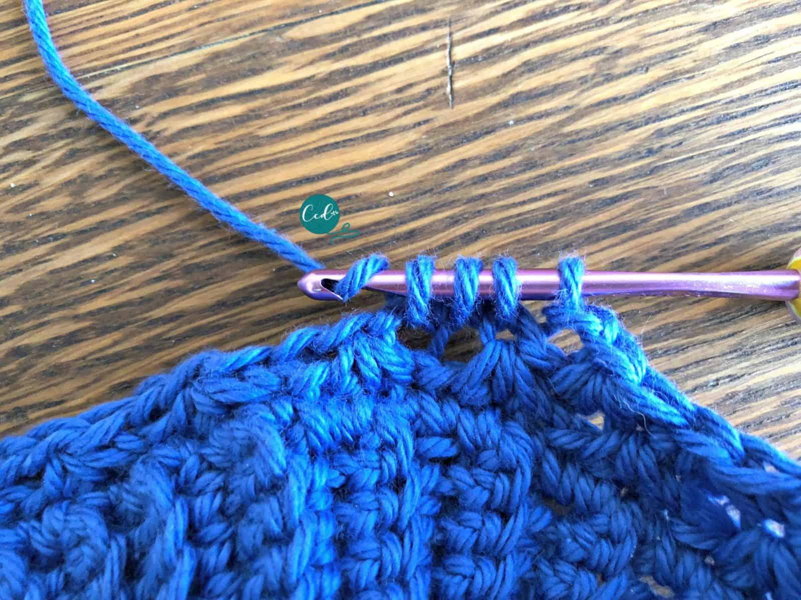 Yarn over for single crochet cluster.