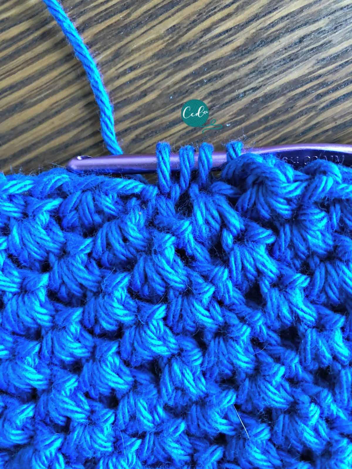 Cluster stitch at start of round.