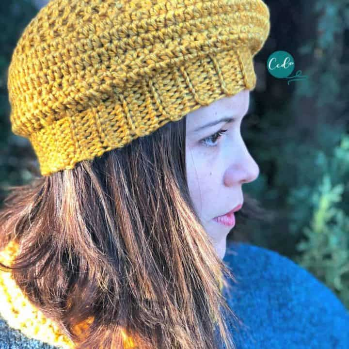 Woman in yellow crochet beret.