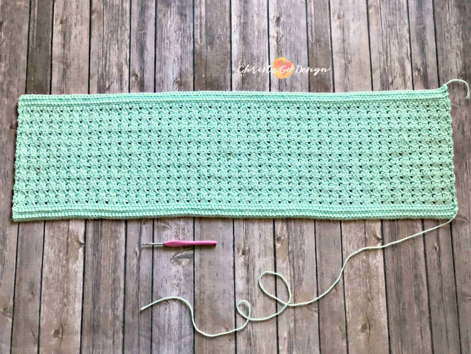The cowl laid flat in a rectangle.