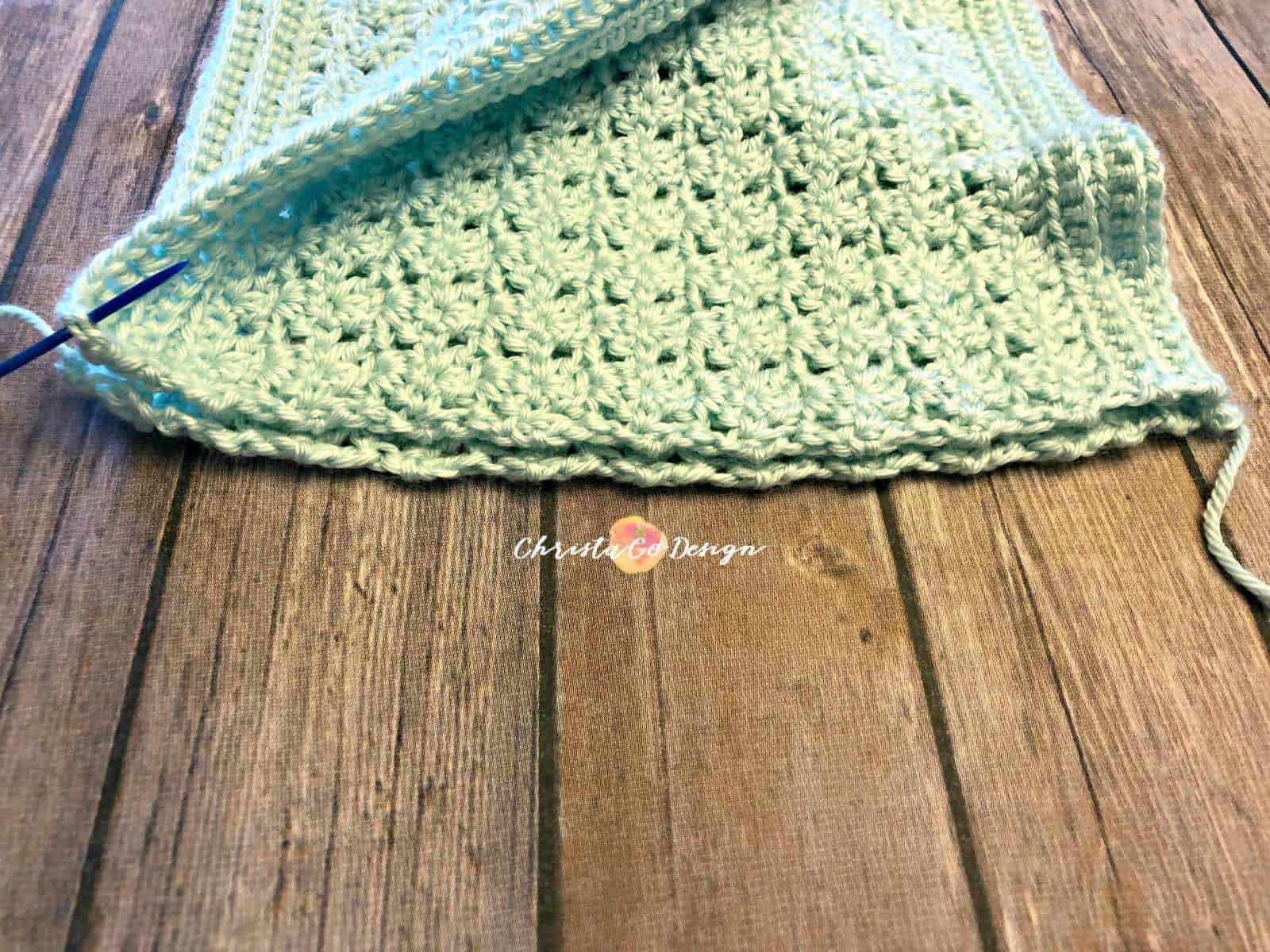 Seaming mint green cowl together.