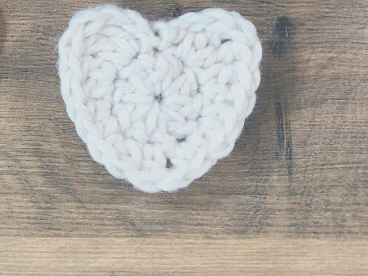 White crochet heart in chunky yarn.