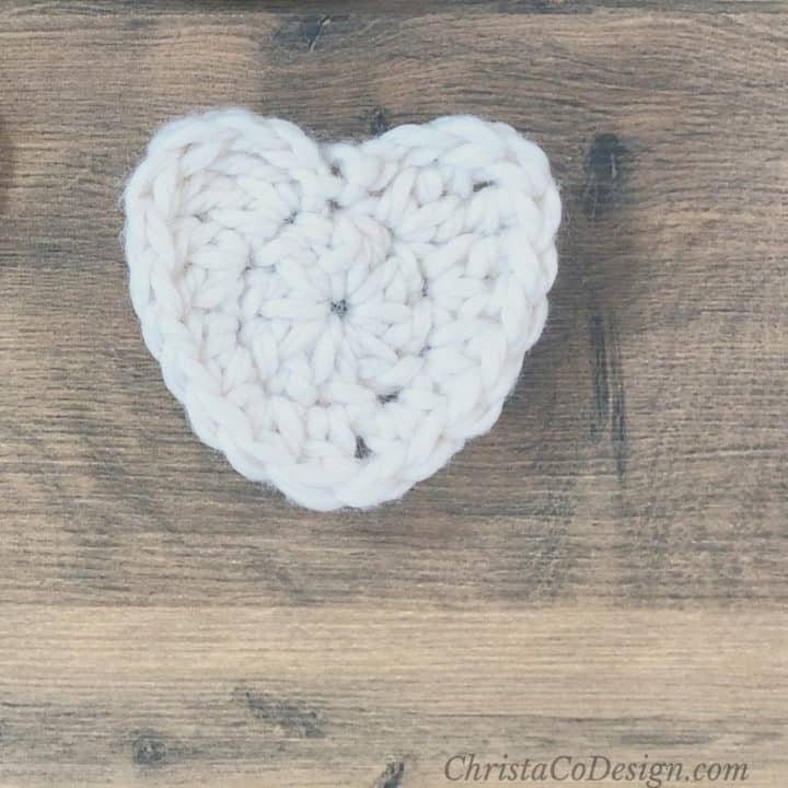 White crochet heart in chunky yarn.