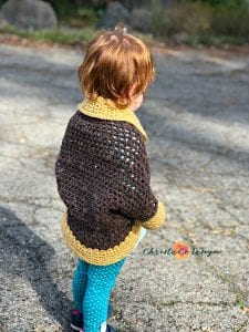 picture of toddler in crochet shrug with bobbles
