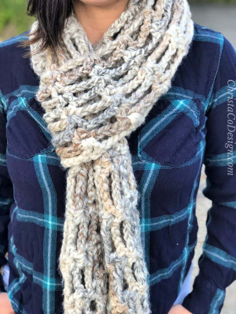 Close up of scarf looped through.