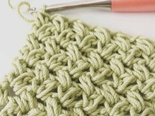 picture of green crochet mini bean stitch swatch peach crochet hook