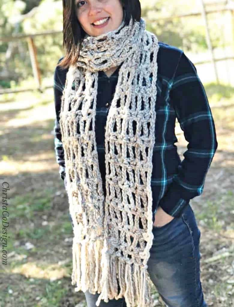 Chunky scarf with fringe on smiling woman.