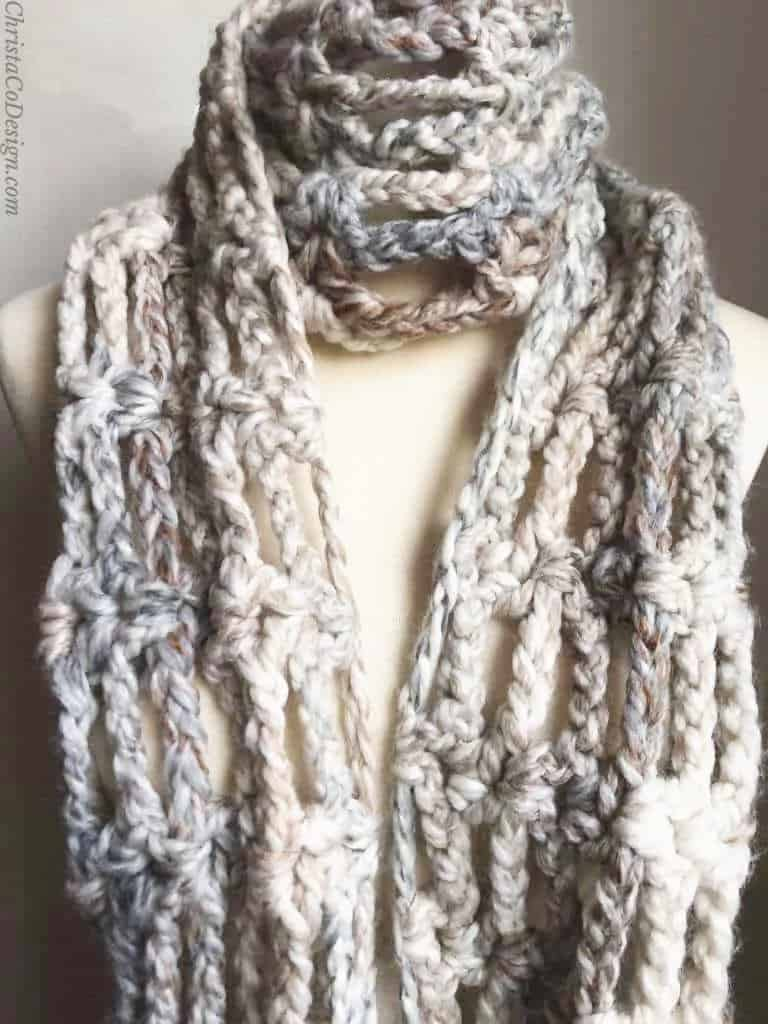 Super chunky crochet scarf on mannequin.