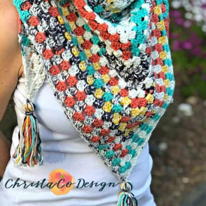 Colorful crochet scarf in granny triangle.