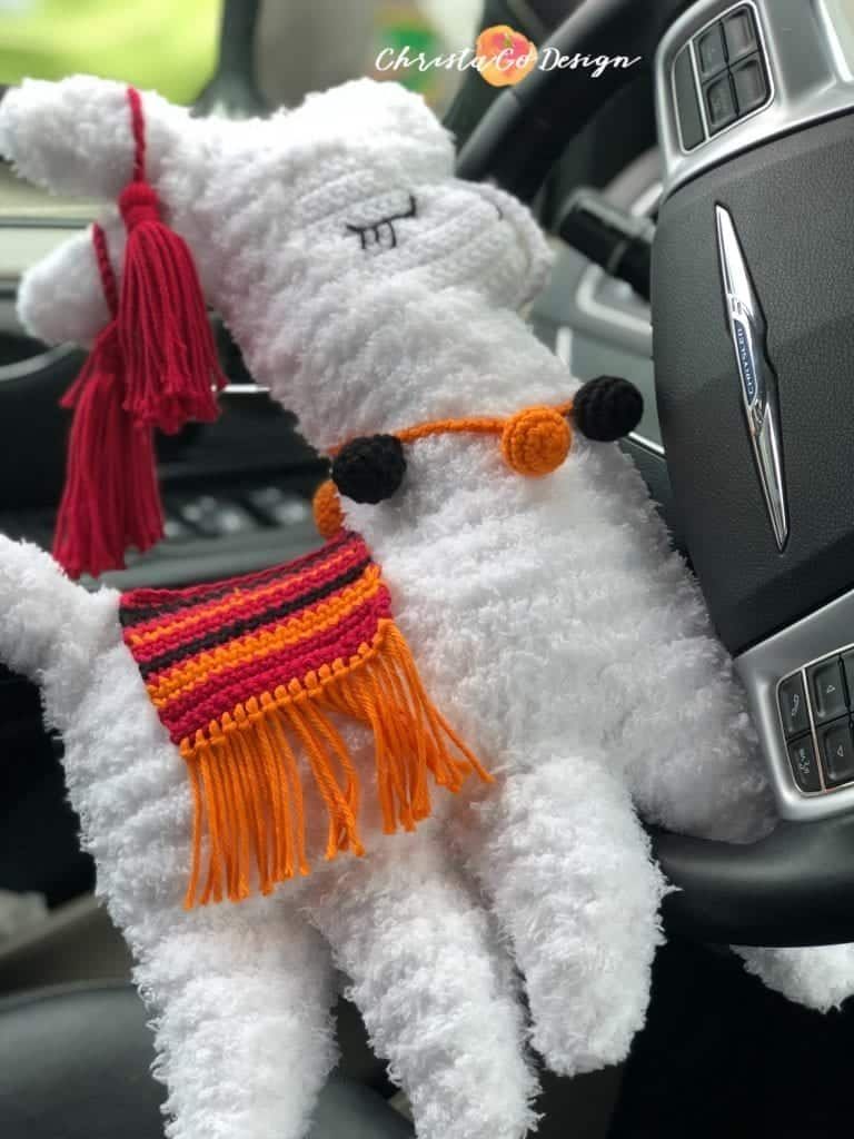 picture of fuzzy llama driving