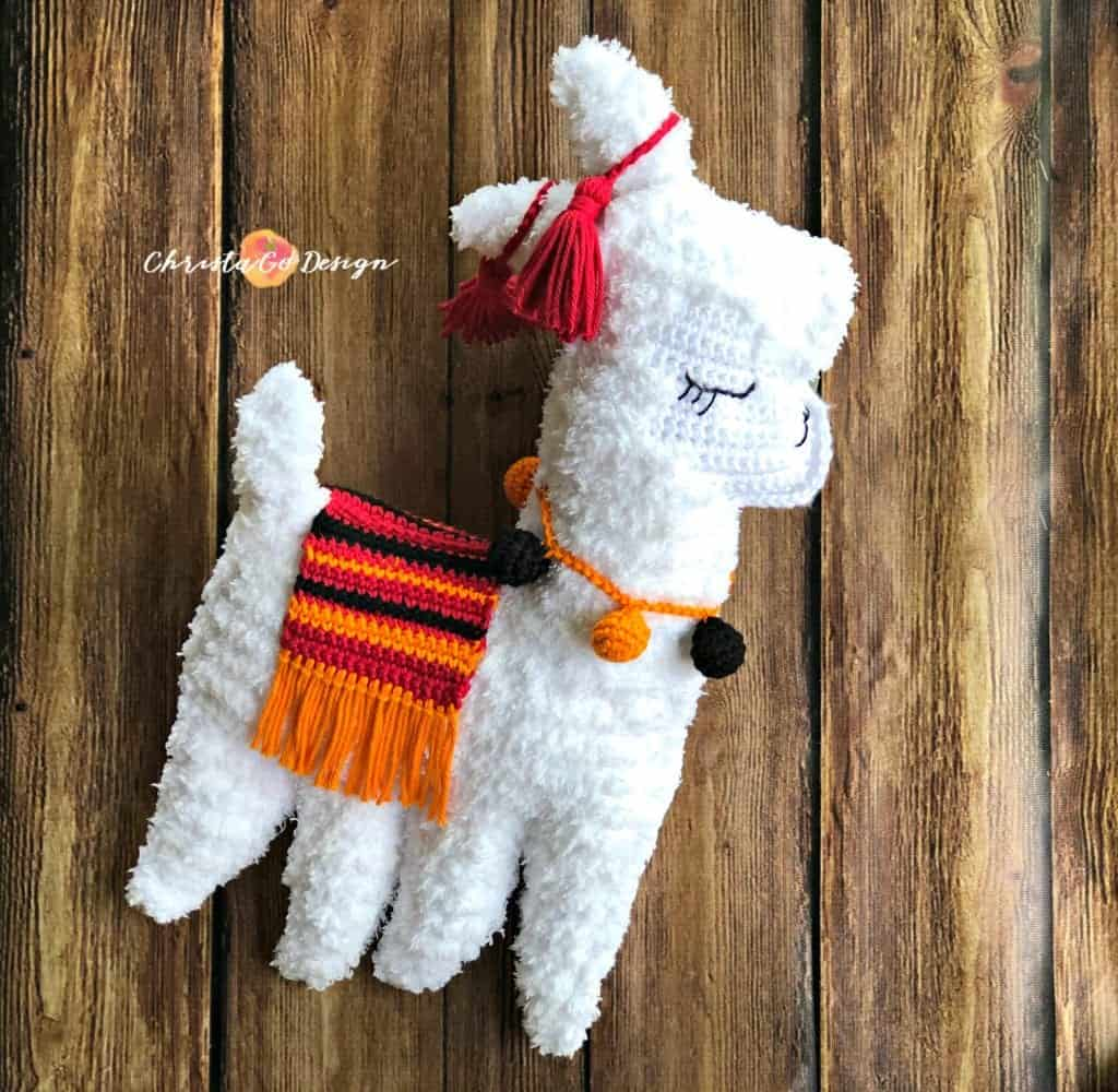 picture of fuzzy llama complete with blanket
