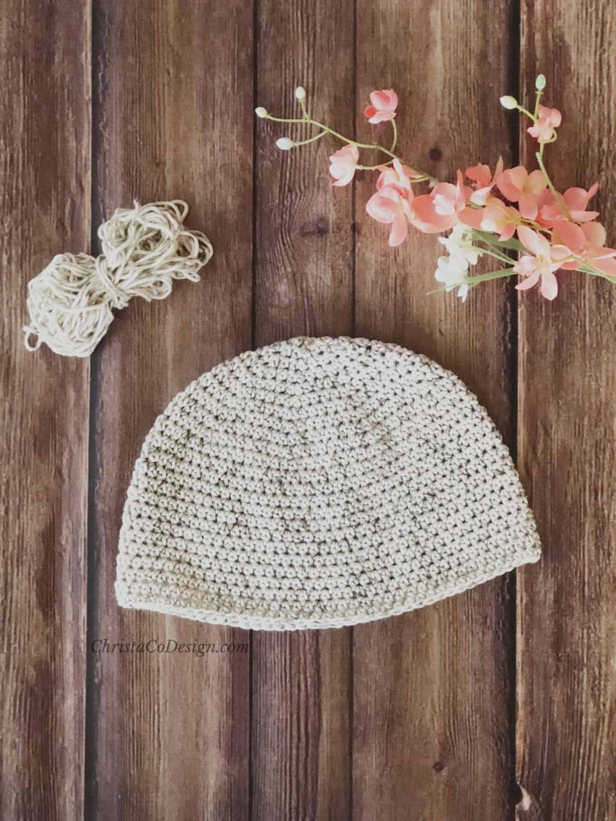 picture of soft cotton chemo cap and pink flowers flat