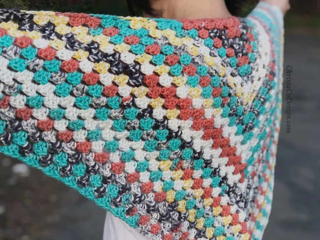 Back view of granny triangle shawl free crochet pattern.