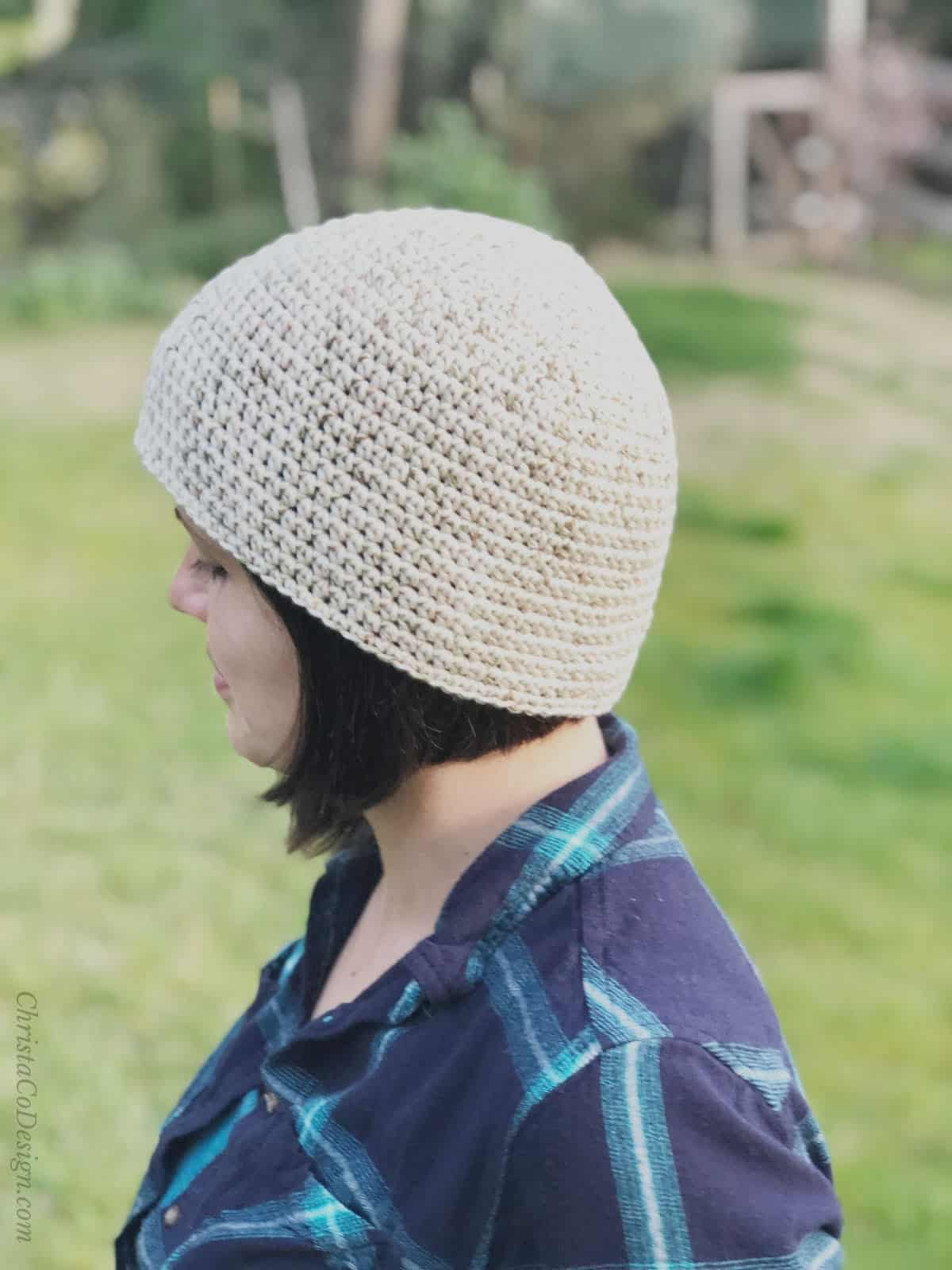 picture of woman in blue with cotton chem cap on