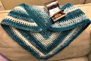 picture of crochet shawl on couch