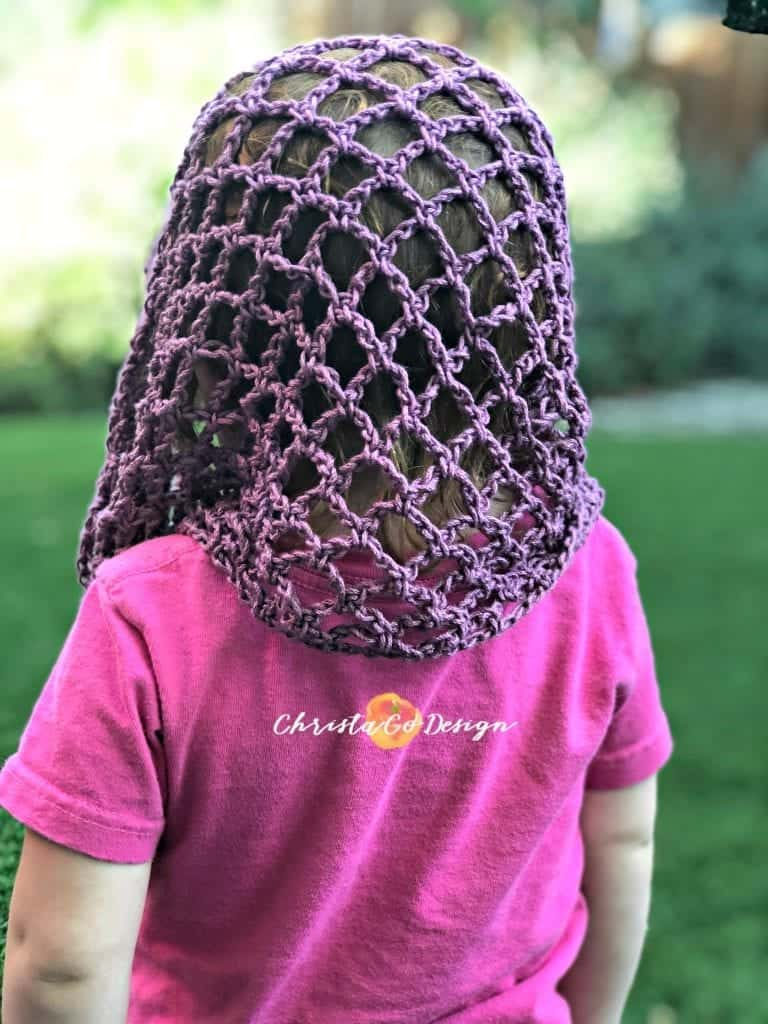 picture of draped crochet arches on girl's head