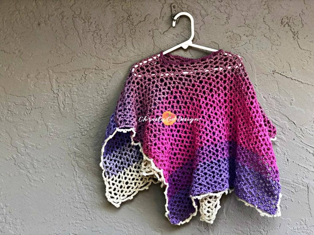 picture of hanging in pink and purple merletto crochet lace poncho
