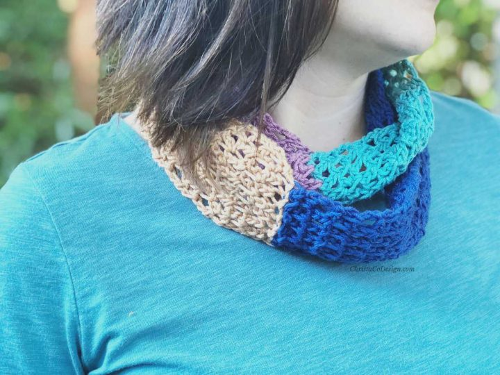 A crochet cowl in blocks of color.