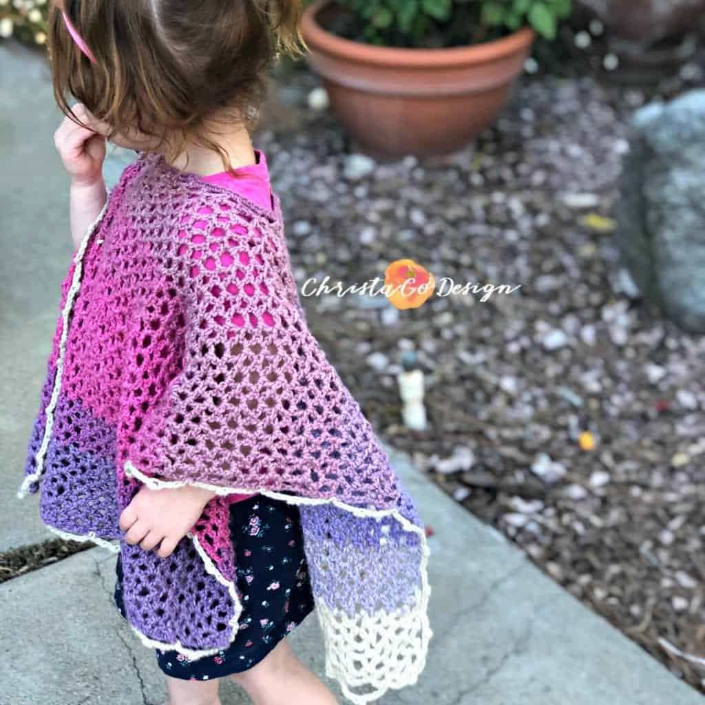 picture of toddler in pink merletto poncho