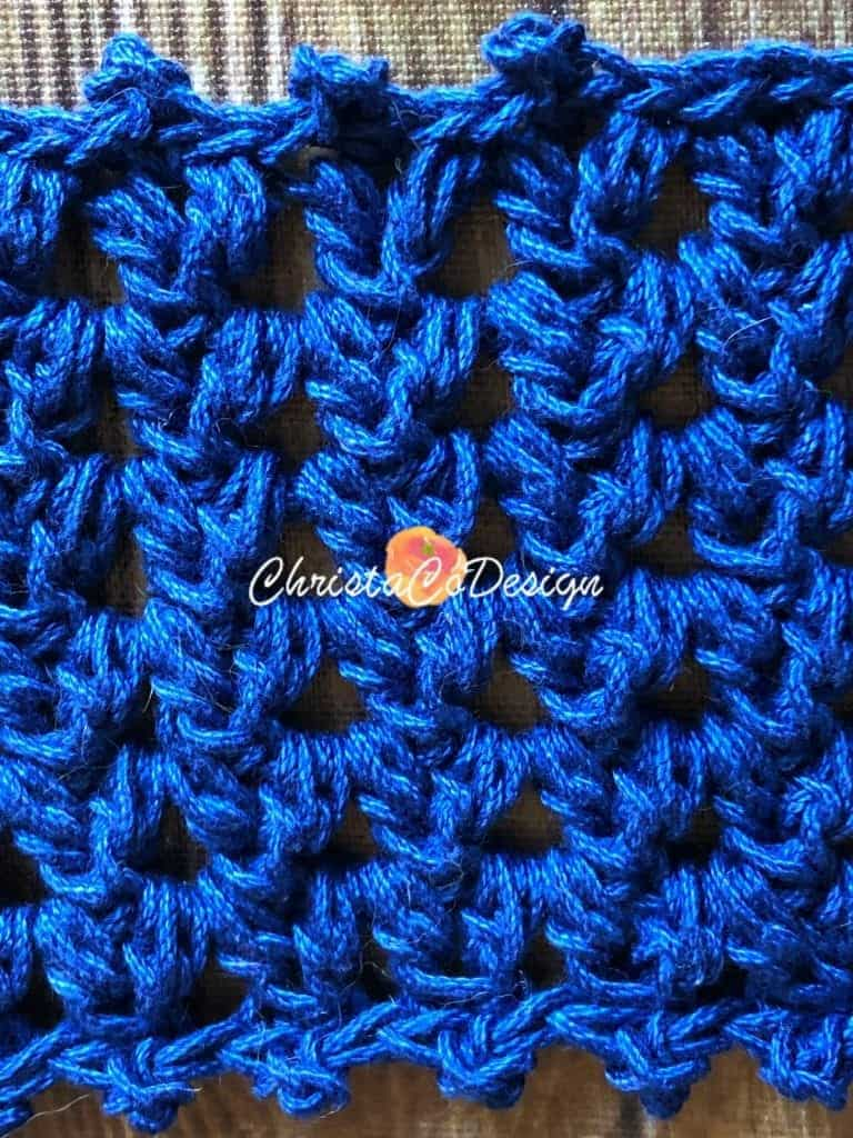 Close up of forked cluster stitch used in crochet cowl.