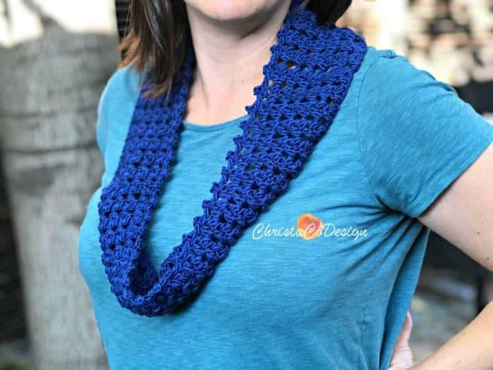 Woman in blue crochet cowl.