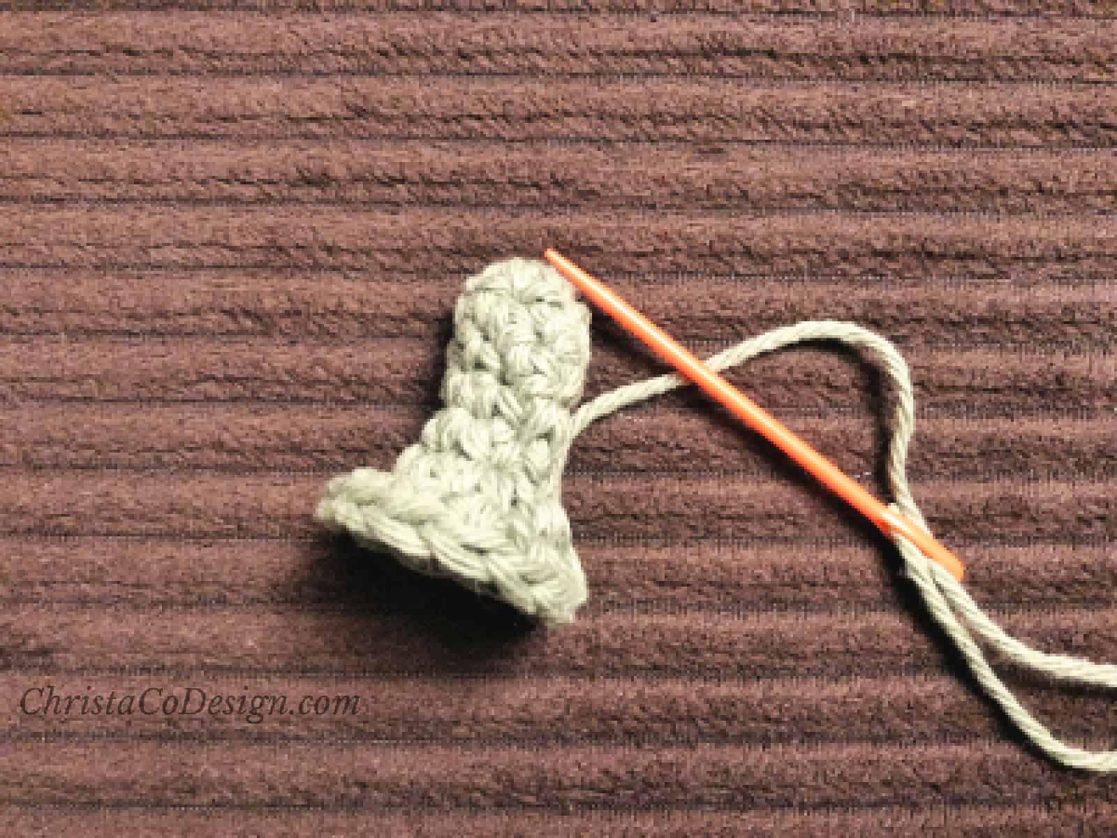 Green stem for pumpkin hat crochet pattern.